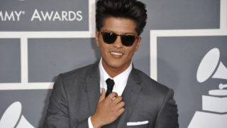 Bruno Mars poses on the red carpet at the Staples Center for the 54th Grammy Awards in Los Angeles/ JOE KLAMAR/AFP/Getty Images)