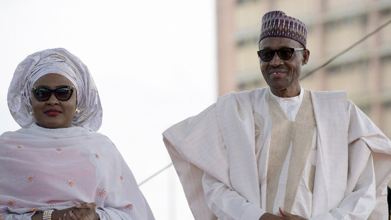 Nigerian President Mohammadu Buhari arrives with his wife Aisha, before taking oath of office in Abuja, on May 29, 2015 PHOTO: AFP/Pius Utomi Ekpei