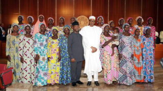 President Muhammadu Buhari and Vice President Yemi Osinbajo (centre) with the 21 Chibok girls freed by Boko Haram. The girls were received by the president at the State House, Abuja on Wednesday, October 19, 2016. PHOTO: TWITTER/PODE