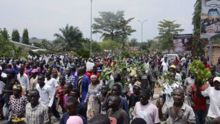 """People demonstrate against the European Union, the International Criminal Court and the Resolution against Burundi in Bujumbura on October 8, 2016. Burundi announced plans on October 7, 2016 to withdraw from the International Criminal Court (ICC), a week after the UN began an enquiry into human rights abuses committed since April 2015. """"It is perfectly clear that this is a plot to do harm to Burundi,"""" said Gaston Sindimwo, Burundi's vice president, citing European Union """"pressure"""" allegedly exerted on the UN, which opened a rights investigation a week ago. According to a list seen by AFP, the UN investigation is targeting a dozen members of the governing regime, including General Alain-Guillaume Bunyoni, regarded as the second most powerful figure after President Pierre Nkurunziza.  / AFP PHOTO / STRINGER"""