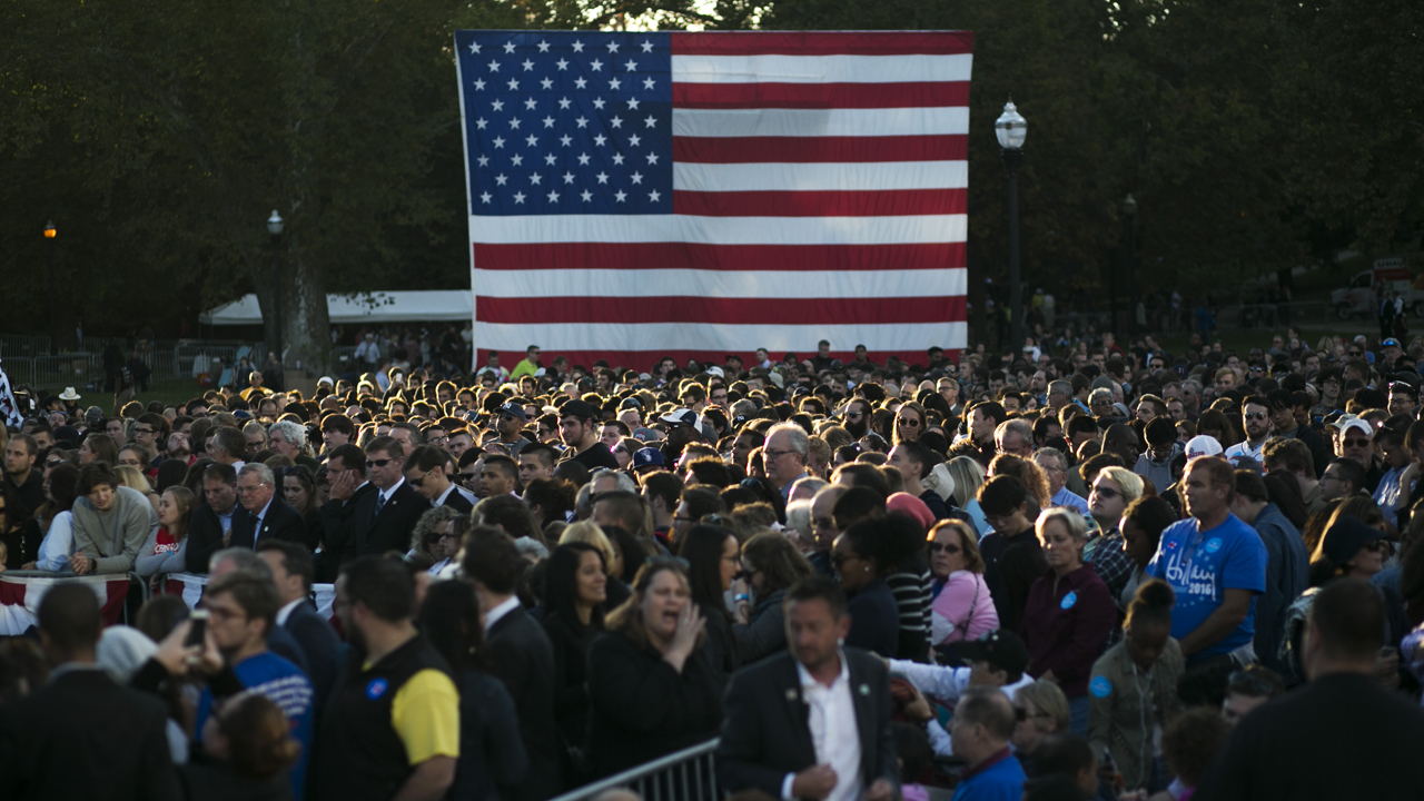 COLUMBUS, OH - OCTOBER 10: People wait for Democratic presidential nominee Hillary Clinton to arrive at Ohio State University on October 10, 2016 in Columbus, Ohio. A day after the second presidential debate in St. Louis, Hillary Clinton is campaigning in Michigan and Ohio.   Maddie McGarvey/Getty Images/AFP