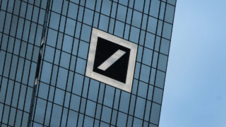 (FILES) This file photo taken on January 28, 2016 shows the headquarter building of Deutsche Bank, Germany's biggest lender in Frankfurt. Deutsche Bank is near a deal with US officials to slash a huge fine over its dealings prior to the 2008 financial crisis, a source said September 30, 2016, sparking a dramatic rally in the German giant's shares. Stock in Germany's biggest lender closed at 11.57 euros ($13), up 6.39 percent on Thursday's close after a flurry of last-minute buying activity following the news the bank had negotiated a much lower fine than expected with the US Department of Justice.  / AFP PHOTO / DANIEL ROLAND