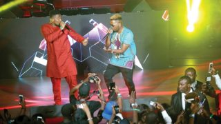 Olamide (left) with OAP Do2Tun on stage at the Road To Mama concert in Lagos.