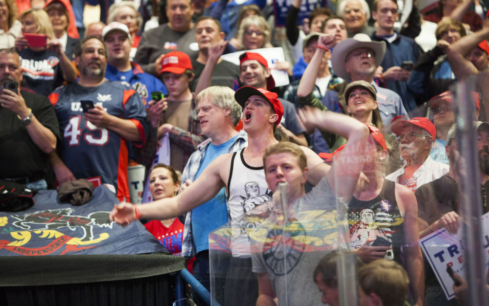 WILKES-BARRE, PA - OCTOBER 10: Supporters cheer at a campaign rally for Republican presidential nominee Donald Trump on October 10, 2016 in Wilkes-Barre, Pennsylvania. Trump continues his campaign following a town hall style debate against the Democratic nominee Hillary Clinton at Washington University in St. Louis last night. Jessica Kourkounis/Getty Images/AFP