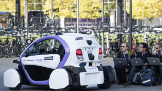 Technicans analise data follwong the trial of an autonomous self-driving vehicle in a pedestrianised zone, during a media event in Milton Keynes, north of London, on October 11, 2016. Driverless vehicles carrying passengers took to Britain's streets for the first time on Tuesday in a landmark trial which could pave the way for their introduction across the country. The compact two-seater cars trundled along a pedestrianised zone in Milton Keynes, north of London, in a trial by Transport Systems Catapult (TSC) which plans to roll out 40 vehicles in the city. / AFP PHOTO / JUSTIN TALLIS