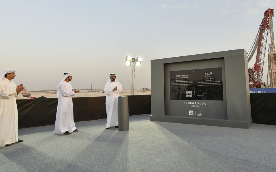 Sheikh Mohammed Bin Rashid al-Maktoum (R), Ruler of Dubai, Mohammad Alabbar (L), chairman of Emaar Properties and Sheikh Hamdan bin Mohammed bin Rashid al-Maktoum (C), Crown Prince of Dubai, are seem during a groundbreaking ceremony of The Tower at Dubai Creek Harbour on October 10, 2016 in the Gulf Emirate. Dubai began construction work on a tower that will stand higher than its Burj Khalifa, which is currently the world's tallest skyscraper. Designed by Spanish-Swiss architect Santiago Calatrava Valls, the tower will have observation decks providing 360-degree views of the coastal city.  / AFP PHOTO / STRINGER
