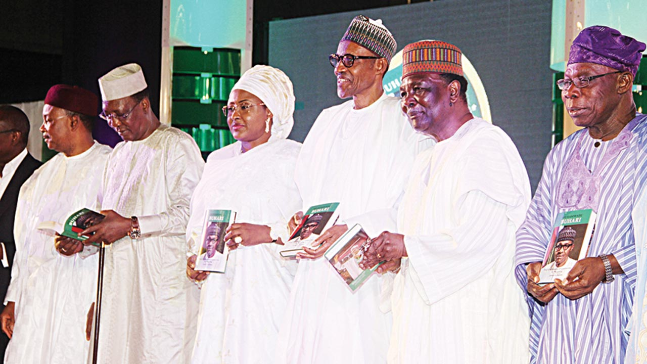 Niger Republic President Issifou Mahamadou (left); his Chadian counterpart, Idriss Deby; Nigerian First Lady, Hajia Aisha Buhari; President Muhammadu Buhari; former Head of State, Gen Yakubu Gowon and ex-President Olusegun Obasanjo at the presentation of the book, President Muhammadu Buhari: The Challenges of Leadership in Nigeria at the International Conference Centre Abuja …yesterday. PHOTO: PHILIP OJISUA