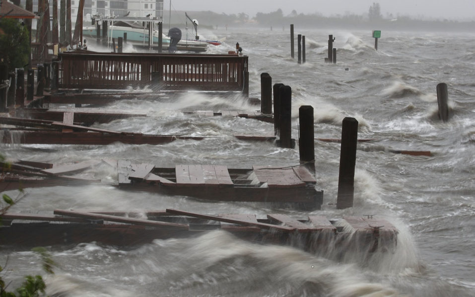 COCOA BEACH, FL - OCTOBER 07: Heavy waves caused by Hurricane Matthew pound the boat docks at the Sunset Bar and Grill, October 7, 2016 on Cocoa Beach, Florida. Hurricane Matthew passed by offshore as a catagory 3 hurricane bringing heavy winds and minor flooding.   Mark Wilson/Getty Images/AFP