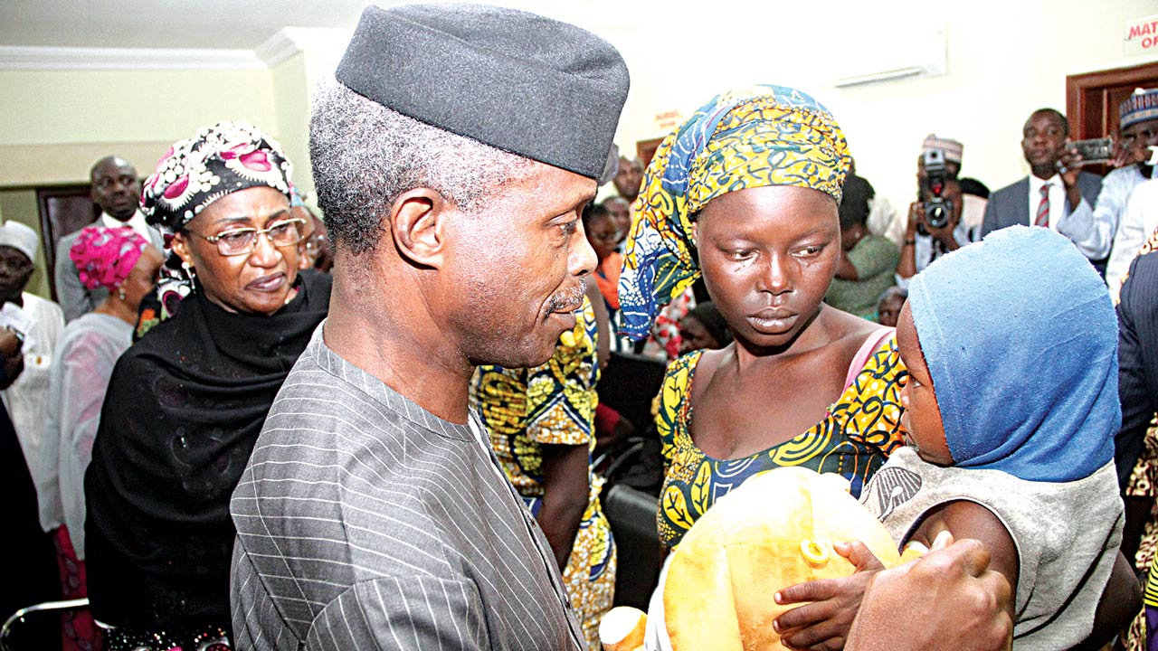 Vice President Yemi Osinbajo (left) with one of the freed Chibok girls and her baby in Abuja... yesterday