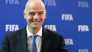 FIFA president Gianni Infantino smiles after a meeting of the FIFA Council on October 14, 2016 at the world football's governing body headquarters in Zurich.  FIFA executives will make a final decision on World Cup reform in January after weighing up three proposals on Thursday, as president Gianni Infantino pushes plans to grow the lucrative tournament. / AFP PHOTO / FABRICE COFFRINI
