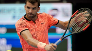 Grigor Dimitrov of Bulgaria hits a return to Steve Johnson of the US during the men's singles first round match of the China Open tennis tournament in Beijing on October 5, 2016. / AFP PHOTO / NICOLAS ASFOURI