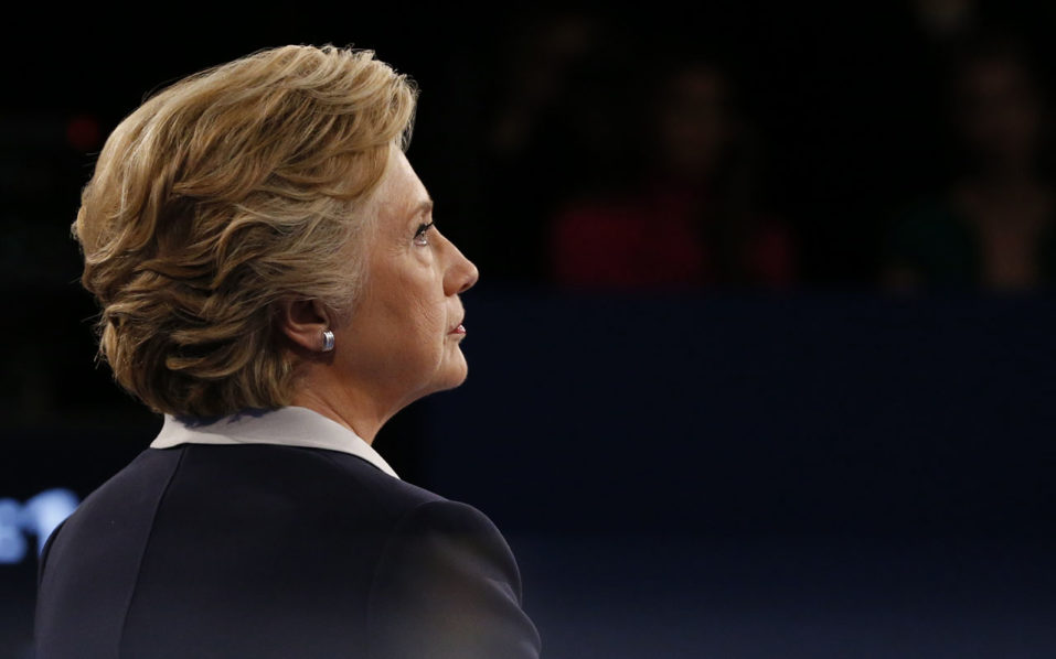 US Democratic presidential candidate Hillary Clinton looks on during the second presidential debate at Washington University in St. Louis, Missouri, on October 9, 2016. / AFP PHOTO / POOL / JIM BOURG