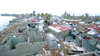 Homes lay in ruins after the passing of Hurricane Matthew in Les Cayes, Haiti, Thursday, October 6, 2016.