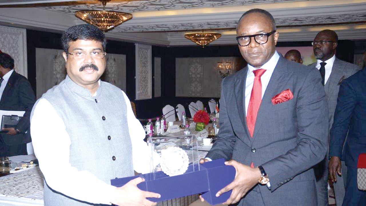 Minister of State for Petroleum Resources, Dr. Emmanuel Ibe Kachikwu (right); receiving a souvenir from the Indian Minister of State in charge for Petroleum  and Natural Gas, Shri Dharmendra Pradhan in India yesterday.