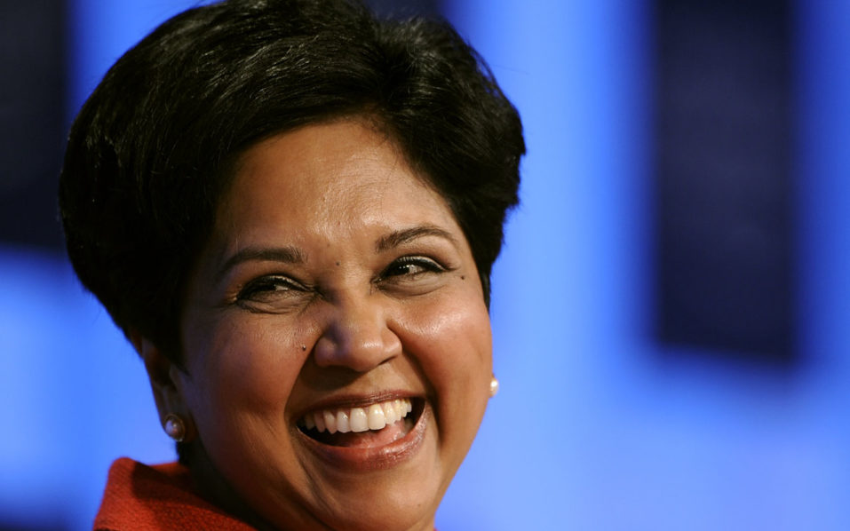 """PepsiCo Chairman and CEO Indra Nooyi smiles during a session untitled """"Technology for Society"""" on the third day of the World Economic Forum (WEF) annual meetingin Davos. PepsiCo set new targets for more healthful food and beverages October 17, 2016 and announced pledges to reduce product packaging and limit water use. With US soda giants under pressure to produce more healthy beverages, Pepsi pledged that by 2025, at least two-thirds of the 12 ounce beverages it sells will contain 100 or fewer calories. At least three-quarters of foods sold will not exceed 1.1 grams of saturated fat per 100 calories. / AFP PHOTO / FABRICE COFFRINI"""