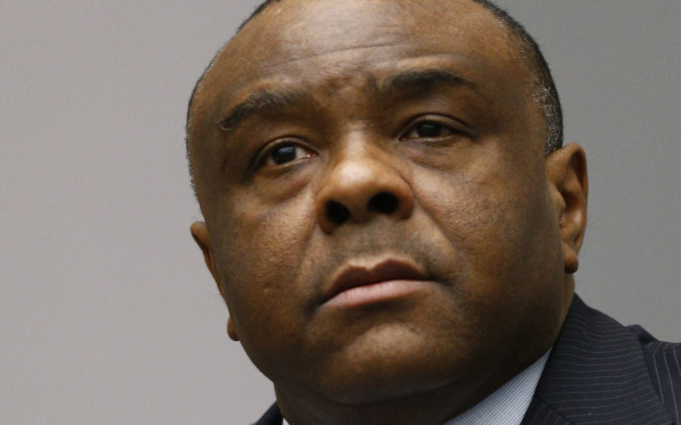 (FILES) This file photo taken on June 21, 2016 shows former Congolese vice-president Jean-Pierre Bemba sits in the courtroom of the International Criminal Court (ICC) in The Hague. The International Criminal Court (ICC) is set to deliver its verdict on October 19, 2016 in the trial of former Congolese Vice President Jean-Pierre Bemba accused of surbonation of witnesses in his trial for war crimes and crimes against humanity. / AFP PHOTO / POOL AND reuters / Michael Kooren