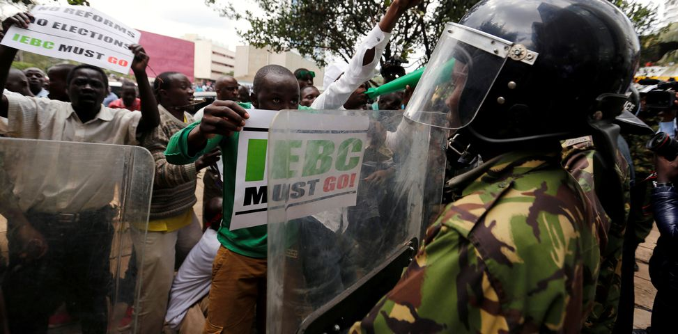 Kenyan opposition Coalition for Reforms and Democracy (CORD) supporters mock riot-policemen during a protest, at the premises hosting the headquarters of Independent Electoral and Boundaries Commission (IEBC), to demand the disbandment of the electoral body ahead of next year's election in Nairobi, Kenya, May 9, 2016. REUTERS/Thomas Mukoya/File Photo