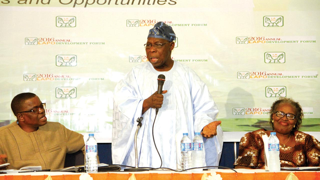 L-R- Founder,Lift above Poverty Organisation(LAPO),Godwin Ehigiamusoe, Former Head of State/President, General Olusegun Obasanjo and Managing Director,Micro Investment Support Services,Mrs Elizabeth Ehigiamusoe during the 23rd LAPO Annual Development Forum and Exhibition in Abuja.