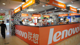 A man walks past a Lenovo shop in a computer mall in Beijing . AFP PHOTO/Peter PARKS