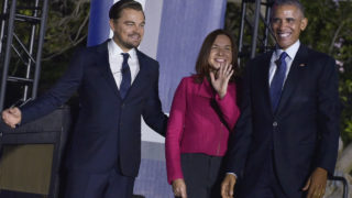 "From left: Actor Leonardo DiCaprio, climate scientist Katharine Hayhoe and US President Barack Obama arrive on stage for a discussion on climate change  during the ""South by South Lawn"" (SXSL) festival at the White House on October 3, 2016 in Washington, DC. / AFP PHOTO / MANDEL NGAN"