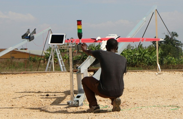 A technician of California-based robotics company Zipline launches a drone in Muhanga, west of the capital Kigali on October 12, 2016. PHOTO: Stephanie Aglietti (AFP/File)