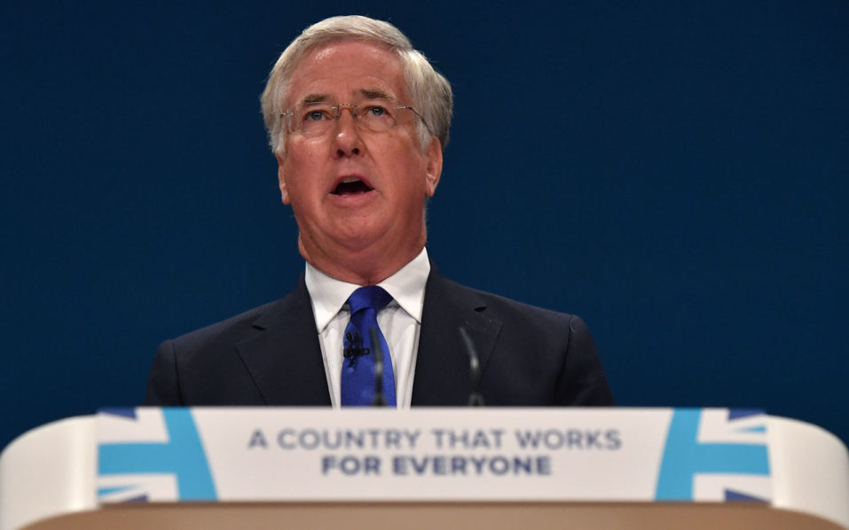 British Defence Secretary Michael Fallon delivers a keynote address on the third day of the annual Conservative Party conference at the International Convention Centre in Birmingham, central England, on October 4, 2016.  British Prime Minister Theresa May announced at the weekend that her Conservative government would start the process of leaving the EU within the next six months -- possibly leading to Britain severing ties with the single market. / AFP PHOTO / BEN STANSALL