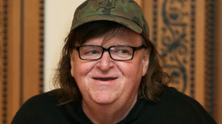 US filmmaker Michael Moore, pictured in June 2016, announced the surprise release of a new movie about Donald Trump (AFP Photo/Daniel Leal-Olivas)