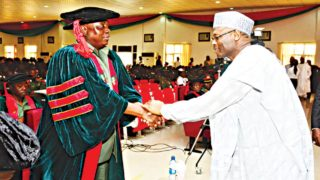 Chairman, Independent National Electoral Commission NEC Chairman, Prof Mahmood Yakubu (left) in a handshake with the Commandant, Nigerian Defence Academy (NDA), Major General M.T Liman, at the academy's convocation lecture. A multi-purpose hall was named after the former at the institution.