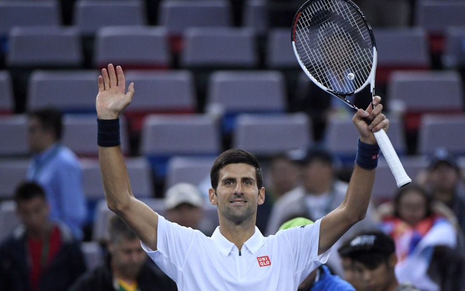 Novak Djokovic of Serbia celebrates after winning against Vasek Pospisil of Canada during their men's singles match at the Shanghai Masters tennis tournament in Shanghai on October 13, 2016. / AFP PHOTO / WANG ZHAO