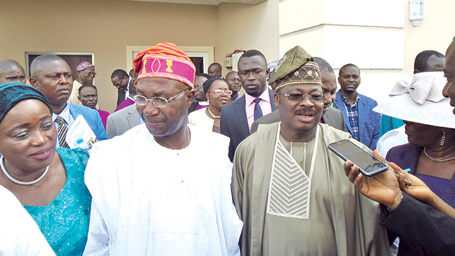 """Oyo State Governor, Abiola Ajimobi (right); the donor and pro-chancellor, Ajayi Crowther University, Oyo, Chief Wole Olanipekun (SAN) and his wife, Omolara, after the commissioning of the """"Wole and Lara Vice Chancellor's Lodge,"""" at the institution recently"""