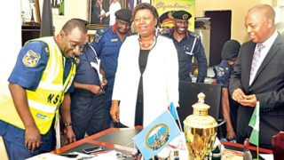 Commandant General of the Nigeria Security and Civil Defence Corps (NSCDC), Abdullahi Gana Muhammadu (left), MD/CEO, Trustfund Pensions Limited, Helen Da-Souza and the Executive Director, Corporate Services, Mallam Musa Nasr during the presentation of 5,000 reflective jackets to the corps in Abuja… yesterday.