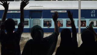 "Pakistani relatives wave towards Indian travelers as they leave on the India-bound Samjhota Express from Lahore Railway Station in Lahore on September 26, 2016.  The Samjhota Express train service, which runs between New Delhi and Lahore, has resumed a few hours after its suspension by Indian authorities. Indian Prime Minister Narendra Modi lashed out at Pakistan September 24 accusing it of ""exporting terrorists"" after a deadly attack on an army base that New Delhi has blamed on Pakistan-based militants. Modi's comments were the latest in a war of words between the neighbours over escalating tensions in disputed Kashmir, where 18 Indian soldiers were killed last week in the worst attack in the region for over a decade. / AFP PHOTO / ARIF ALI"