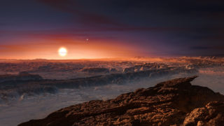 """(FILES) This handout file photo provided by the European Southern Observatory and taken on August 24, 2016 shows an artist's impression of a view of the surface of the planet Proxima b orbiting the red dwarf star Proxima Centauri, the closest star to the Solar System.  A rocky planet discovered in the """"habitable"""" zone of the star nearest our Sun may be covered with oceans, researchers at France's CNRS research institute said October 6. A team including CNRS astrophysicists have calculated the size and surface properties of the planet dubbed Proxima b, and concluded it may be an """"ocean planet"""" similar to Earth / AFP PHOTO / EUROPEAN SOUTHERN OBSERVATORY / M. Kornmesser /"""