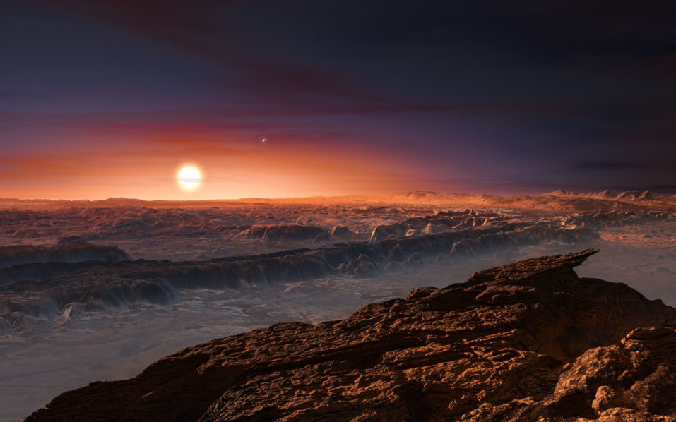 "(FILES) This handout file photo provided by the European Southern Observatory and taken on August 24, 2016 shows an artist's impression of a view of the surface of the planet Proxima b orbiting the red dwarf star Proxima Centauri, the closest star to the Solar System. A rocky planet discovered in the ""habitable"" zone of the star nearest our Sun may be covered with oceans, researchers at France's CNRS research institute said October 6. A team including CNRS astrophysicists have calculated the size and surface properties of the planet dubbed Proxima b, and concluded it may be an ""ocean planet"" similar to Earth / AFP PHOTO / EUROPEAN SOUTHERN OBSERVATORY / M. Kornmesser /"