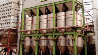 The locally fabricated rice-milling machine. Inset: Nazifi