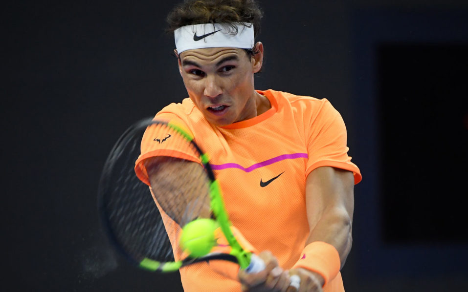 Rafael Nadal of Spain hits a return against Grigor Dimitrov of Bulgaria during the men's singles quater-finals match at the China Open tennis tournament in Beijing on October 7, 2016. / AFP PHOTO / WANG ZHAO