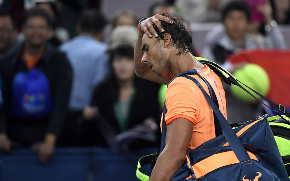 Rafael Nadal of Spain leaves after the men's singles match against Viktor Troicki of Serbia at the Shanghai Masters tennis tournament in Shanghai on October 12, 2016. / AFP PHOTO / WANG ZHAO