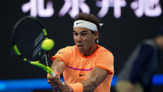 Rafael Nadal of Spain hits a return against Paolo Lorenzi of Italy during the first round of the China Open tennis tournament in Beijing on October 4, 2016. / AFP PHOTO / NICOLAS ASFOURI