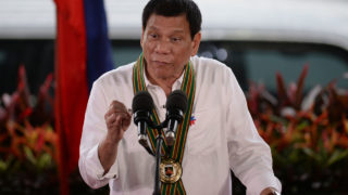 "Philippine President Rodrigo Duterte gestures as he delivers a speech during a ""talk to the troops"" visit to meet military personnel in Manila on October 4, 2016. Rodrigo Duterte launched a fresh tirade at the United States on October 4, telling Barack Obama to ""go to hell"" as the longtime allies launched war games that the firebrand Philippine leader warned could be their last. / AFP PHOTO / TED ALJIBE"