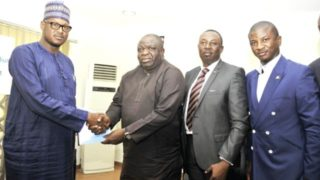 Director General SMEDAN, Dr Dikko Umaru Radda (left); Managing Director, Nicon Insurance Ltd, Bayode Samuel; Executive Director, Technical, Akinshola Ale; and Chief Marketing Officer, Nicon Insurance Ltd,  Samson Davies, during the Signing of MOU Between SMEDAN and NICON Insurance Ltd on provision of insurance for Small and Medium Business Enterprises, in Abuja.