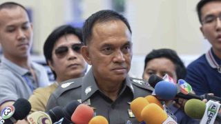 Bangkok police chief Sanit Mahathavorn speaks to media at a police station in Bangkok on September 27, 2016, as he commented on recent police action on a passport forgery ring.  Thai police on September 27 that two men accused of hiding a dismembered body in a Bangkok house freezer and of running a fake passport ring are Americans. The pair were arrested over the weekend along with a third suspect who allegedly opened fire on police during the raid on the shophouse they used as a crime den in the Thai capital. / AFP PHOTO / MUNIR UZ ZAMAN