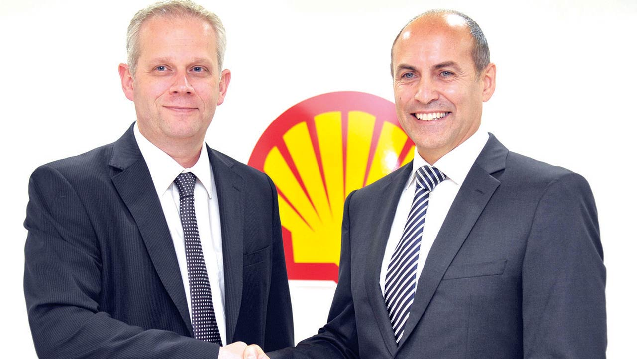 Outgoing Vice President, Shell Nigeria and Gabon, Markus Droll (left) welcoming his successor, Peter Costello in Lagos last Friday.