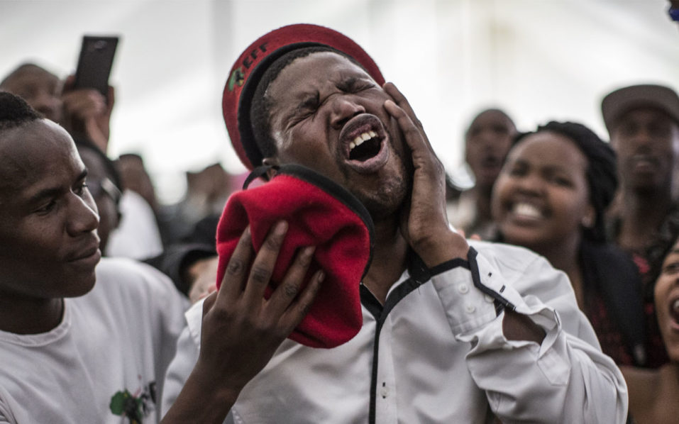 A student wearing a beret from the radical leftist South African political party EFF (Economic Freedom Fighters) reacts during a demonstration on October 7, 2016 in Johannesburg, after the cancellation of the day's General Assembly of the University. Student protesters on October 7 threatened to block next week's planned resumption of lectures at a prestigious South African university if fees are not scrapped immediately, officials and students said. Students at the Johannesburg-based University of Witwatersrand (Wits), where classes have been suspended for nearly three weeks, said they would block the re-opening of campuses October 10, failing free education. / AFP PHOTO / MARCO LONGARI