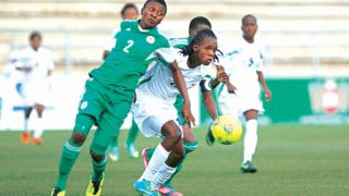 Super Falcons captain, Evelyn Nwabuoku battling for survival at the Sam Nujoma Stadium, Windhoek, Namibia in 2014.