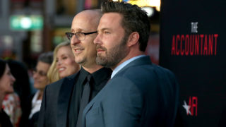 """HOLLYWOOD, CA - OCTOBER 10: Director/producer Gavin O'Connor (L) and actor Ben Affleck attend the premiere of Warner Bros Pictures' """"The Accountant"""" at TCL Chinese Theatre on October 10, 2016 in Hollywood, California.   Frederick M. Brown/Getty Images/AFP"""