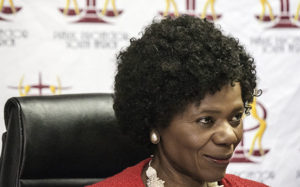 Outgoing South African Public Protector Advocate Thuli Madonsela waves as she arrives for her last press briefing before leaving office at the Public Protector headquarter on October 14, 2016 in Pretoria. A potentially explosive report into corruption allegations against South African President Jacob Zuma will not be released on October 14, 2016 as expected, lawyers said during last-minute court proceedings. The investigation by Public Protector Thuli Madonsela was to be unveiled in Pretoria, one day before she steps down from a job in which she has regularly clashed with the president. Madonsela's report probed allegations that Zuma allowed the wealthy Gupta family to have undue influence over government, even having the power to nominate cabinet ministers. / AFP PHOTO / GIANLUIGI GUERCIA