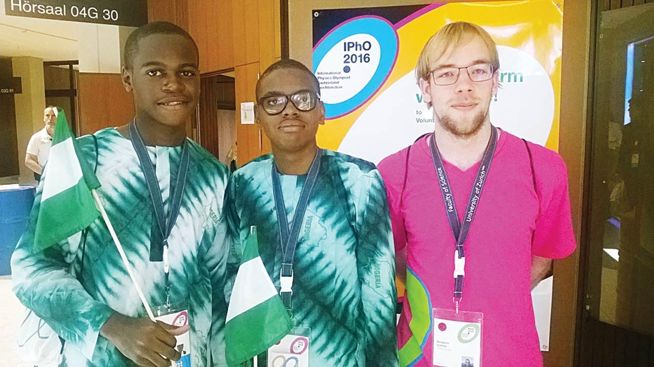 Ebuka Okoli and Amaechi Abuah at the International Physics Olympiad (IPhO), in Switzerland, with their tour guide, Moro Gabriele