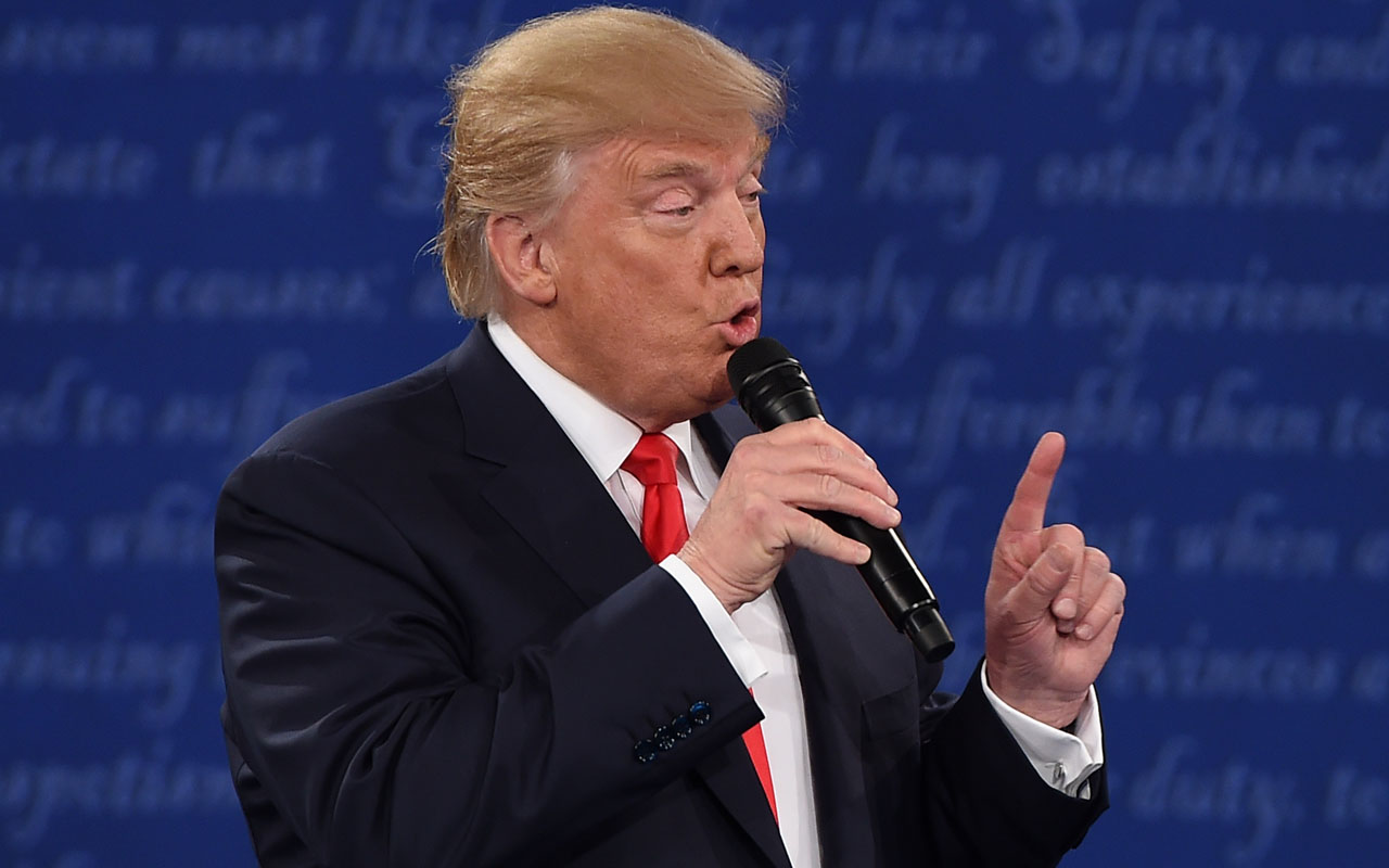 US Republican presidential candidate Donald Trump speaks during the second presidential debate at Washington University in St. Louis, Missouri, on October 9, 2016. / AFP PHOTO / Robyn Beck