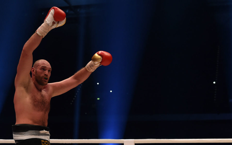 "(FILES) This file photo taken on November 28, 2015 shows British Tyson Fury celebrates after the WBA, IBF, WBO and IBO title bout against Ukrainian world heavyweight boxing champion Wladimir Klitschko in Duesseldorf, western Germany. Fury won the fight after 12 Rounds of Boxing. Controversial world heavyweight champion Tyson Fury made an abrupt U-turn on his retirement decision on October 3, 2016, tweeting: ""I'm here to stay."" ""Hahahaha u think you will get rid of the GYPSYKING that easy!!! I'm here to stay,"" Fury wrote on Twitter.he provocative 28-year-old British brawler, dogged by reports he failed a drugs test for cocaine, had earlier declared himself ""retired"" in a profanity-strewn tweet. / AFP PHOTO / PATRIK STOLLARZ"