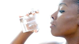 Drinking water...Over-drinking can cause potentially fatal water intoxication. New study challenges the popular idea that we should drink eight glasses of water a day for health.  PHOTO CREDIT:http://blackgirllonghair.com